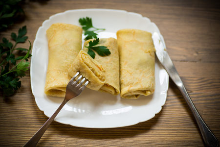 thin fried pancakes stuffed with stewed cabbage in a plate