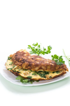 fried omelet with cauliflower and greens in a plate isolated on white background 免版税图像