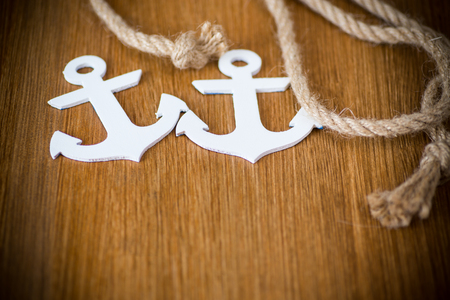 white decorative anchor on a wooden background