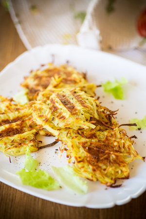 grilled potato pancakes in a plate on a wooden table