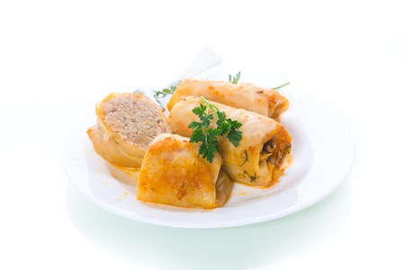 Stuffed cabbage leaves with minced meat and rice in tomato sauce.