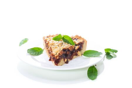 sweet cake with fruit jam in a plate on a white Stock Photo