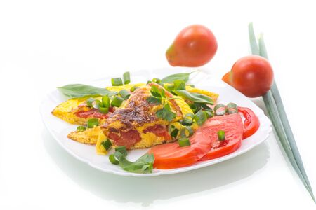 fried omelet from homemade organic eggs with tomatoes and green onions 스톡 콘텐츠 - 127846789