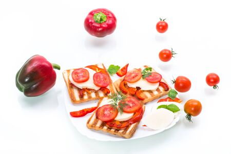 Closeup of a fresh sandwich with mozzarella, tomatoes , on a white background. Stockfoto