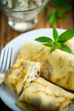 sweet fried thin pancakes with cottage cheese inside