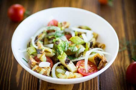 warm grilled zucchini salad with fresh cherry tomatoes and onions