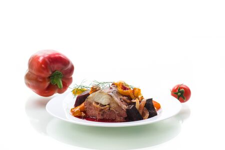 Fish stew with beets and other vegetables in a plate Imagens