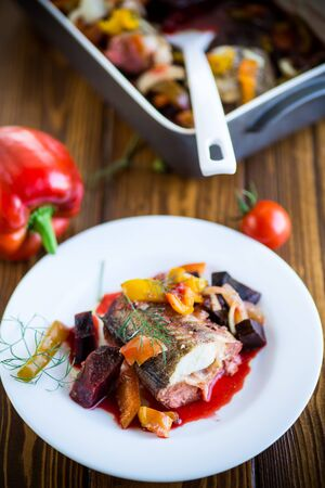 Fish stew with beets and other vegetables in a plate Reklamní fotografie