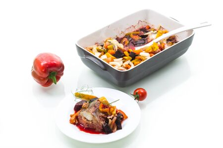 Fish stew with beets and other vegetables in a plate