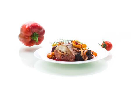 fish stew with beets and other vegetables in a plate, isolated on white background