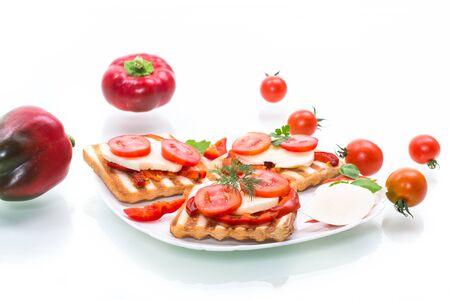 Closeup of a fresh sandwich with mozzarella, tomatoes