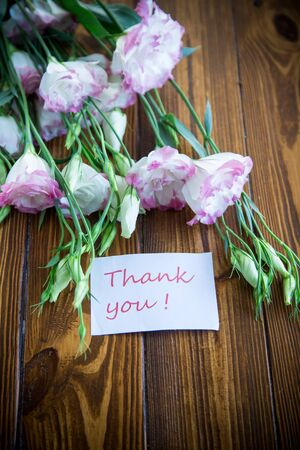beautiful pink lisianthus flowers on wooden table