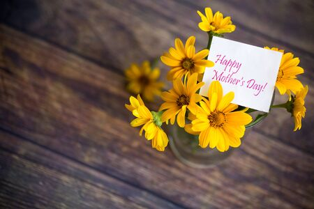 bouquet of beautiful blooming daisies on a wooden table