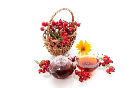 hot tea from medicinal fruits of red ripe rosehip, isolated on white background