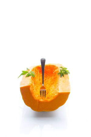 half ripe organic pumpkin isolated on white background Stock Photo