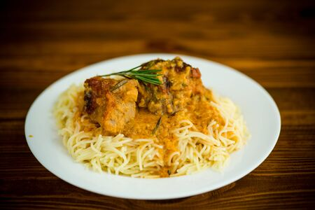 boiled vermicelli with meat and gravy in a plate