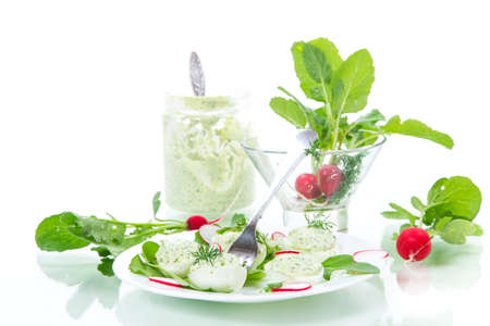 boiled stuffed eggs with green cheese filling with arugula leaves and radish Stock Photo