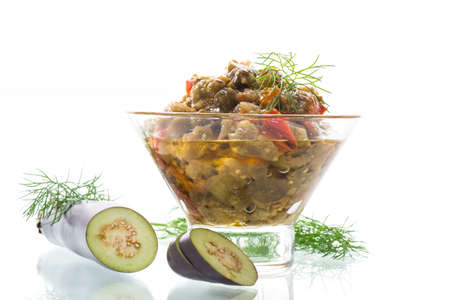 cooked summer eggplant caviar with vegetables in a bowl on white background