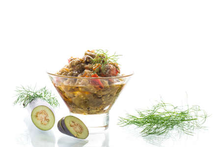 cooked summer eggplant caviar with vegetables in a bowl on white background Standard-Bild