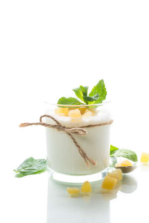 Sweet homemade yogurt with candied fruits in a glass isolated on white background Stock fotó