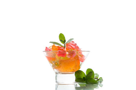 colored sweet fruit jelly in glass glass isolated on white background