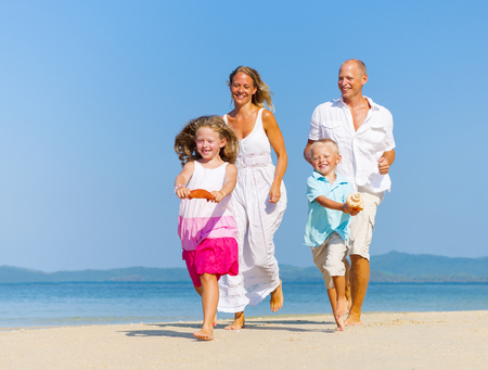 Family Running On The Beach  photo