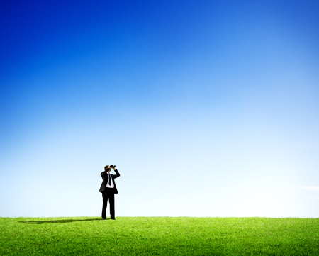opportunity discovery: Businessman Outdoors with Binoculars Looking For Future Oportunities
