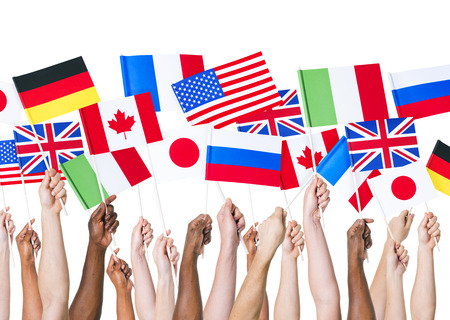 Diverse Hands Holding National Flags 版權商用圖片