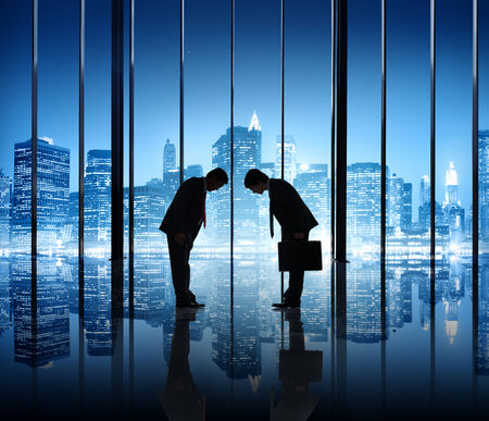 bowing: Two Businessmen Greeting and Bowing in New York