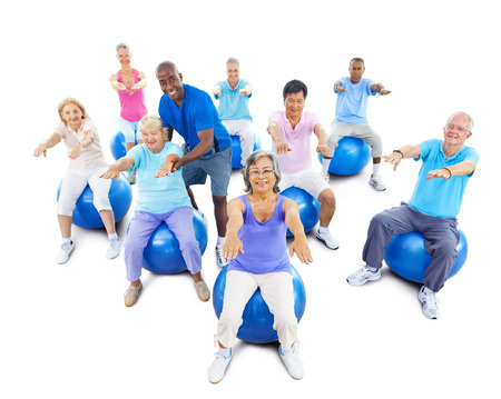Group Of Multi-Ethnic Senior Adults Exercising With The Instructor photo