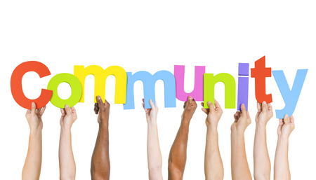word: Multi Ethnic People Holding The Word Community