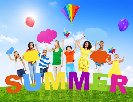 Group of Mixed Age Holding Colorful Speech Bubbles in a Summer Concept Photo photo