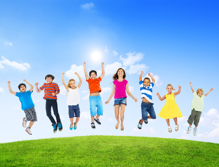 ethnic children: Group of Diverse Multi-Ethinc Children Jumping Outdoors