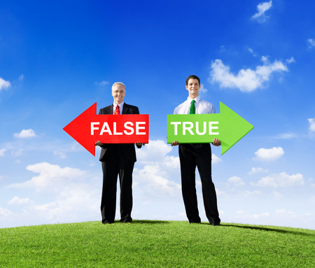 Two Businessmen Holding Contrasting Arrows for False and True photo