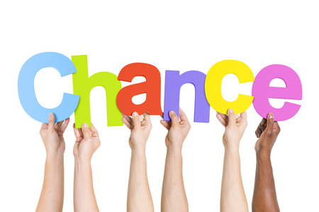 chance: Multi Ethnic People Holding The Word Chance