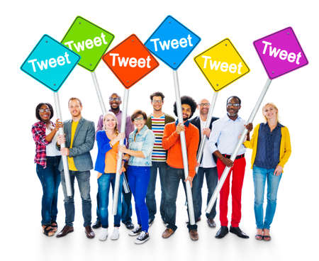 tweet: Group of Multiethnic People Holding Sign Poles with the Word Tweet