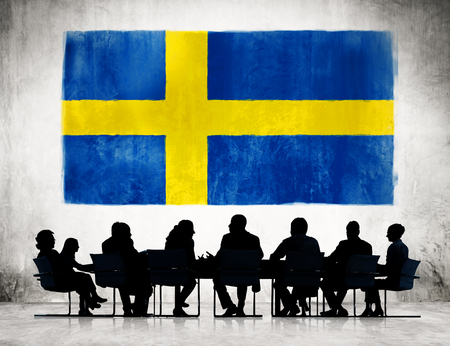 sweden flag: Group of Corporate People Having a Meeting Regarding the National Issues of Sweden