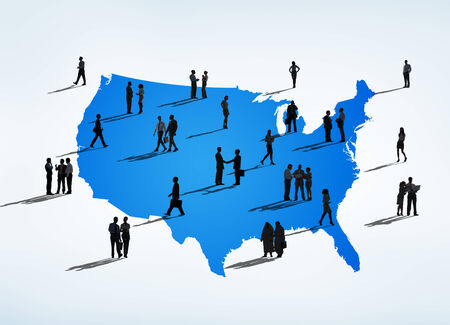 Silhouettes Of Multi-Ethnic Business People On A Blue Cartography Of USA photo