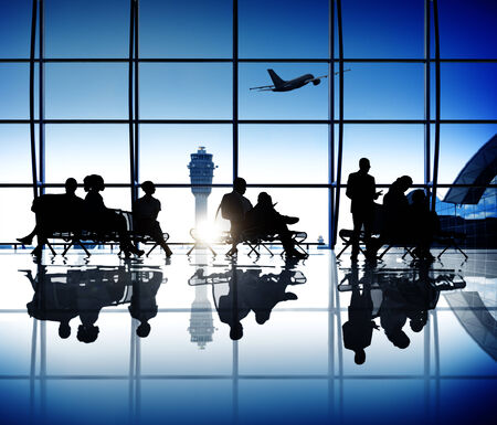 Group of business people waiting in an airport  Imagens