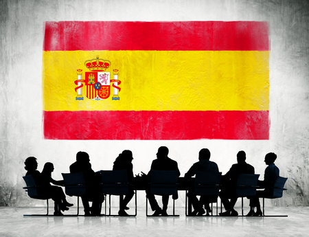 flag of spain: Group of Corporate People Having a Meeting Regarding the National Issues of Spain