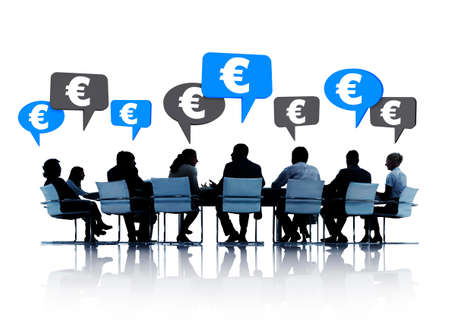 Silhouettes of group of business people discussing Euro around the conference table in white background   photo