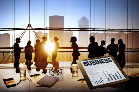 Silhouettes Of Multi-Ethnic Group Of Business People Working Together In A Board Room  photo