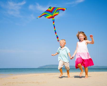 flying man: Children running on the beach