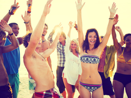 Young adults having beach party in summer