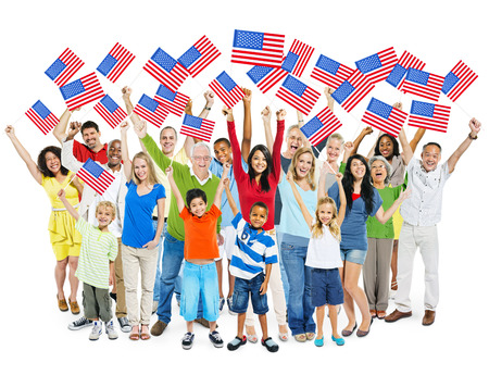 Cheerful Multi-Ethnic Group Of People Standing With Their Arms Raised Holding American Flag  photo