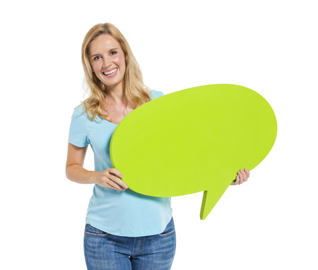 Casual Woman Holding Speech Bubble 版權商用圖片