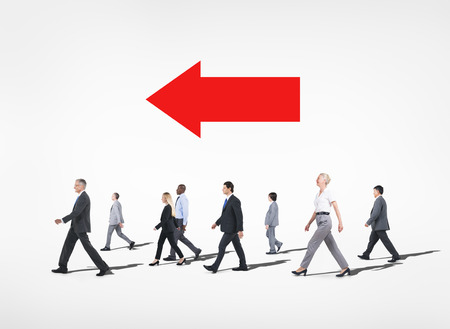 Group of multi-ethnical business people walking in a white background  photo