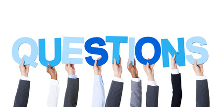 questions: Multiethnic Business People Holding the Word Questions