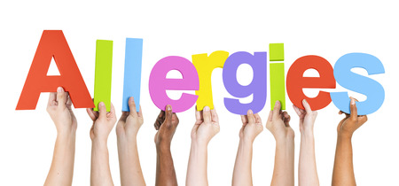 allergens: Group of Multiethnic Hands Holding Allergies Stock Photo