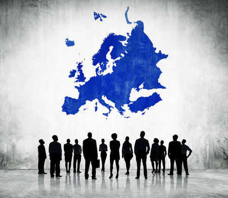 Group Of Business People Standing In A White Background With Blue Europe Cartography Above photo